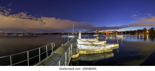 MINNEAPOLIS, MN - MAY 2017 - A Panoramic Shot of South Minneapolis' Bde Maka Ska, or Lake Calhoun, during a Summer Twilight