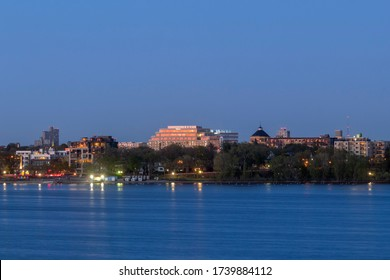 MINNEAPOLIS, MN - MAY 2020 - A Shot of the Apartment Buildings on the Uptown, Minneapolis Skyline over Bde Maka Ska during a Twilight Long Exposure