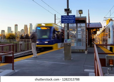 MINNEAPOLIS, MN - OCTOBER 2016 - A Light Rail Train Station and the Minneapolis Skyline during Sunset