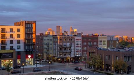 MINNEAPOLIS, MN - OCTOBER 2017 - A Cityscape Shot of Minneapolis under Dramatic Sunset Light