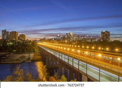 MINNEAPOLIS, MN - OCTOBER 2017 - A Wide Angle Blue Hour Shot over the Washington Avenue Bridge and Downtown Minneapolis during Autumn