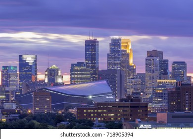 MINNEAPOLIS, MN - SEPTEMBER 2017 - A Close Up Shot of Downtown and Purple Clouds During Twilight