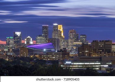 MINNEAPOLIS, MN - SEPTEMBER 2017 - A Close Up Long Exposure Shot of the Downtown Skyline Against Dramatic Blue Blurred Clouds During Late Twilight
