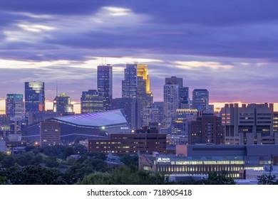 MINNEAPOLIS, MN - SEPTEMBER 2017 - A Medium Close Up Shot of the Cityscape of Minneapolis Against Dramatic Purple Twilight