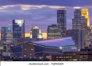 MINNEAPOLIS, MN - SEPTEMBER 2017 - A Telephoto Close Up Long Exposure Shot of the Downtown Skyscrapers and US Bank Stadium Against Dramatic Blue and Purple Clouds During a Late Summer Twilight