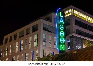MINNEAPOLIS, MN - SEPTEMBER 2019 - A Night Shot of the Lagoon Theater's Neon Sign Illuminated in the Uptown Neighborhood of South Minneapolis