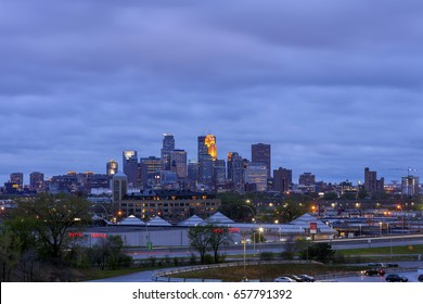MINNEAPOLIS, MN - SPRING 2017 - A Medium Shot of the Minneapolis Skyline and 35W Traffic from Ridgeway Pkwy North of the City on a Cloudy Twilight