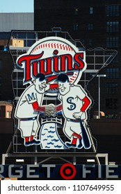 Minneapolis, MN, USA May 15, 2013 Minnesota Twin mascots Minnie and Paul, representing the Twin Cities, adorn a large sign at Target Field in Minneapolis, Minnesota
