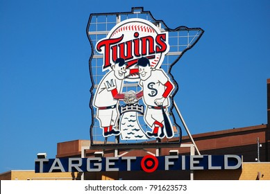 Minneapolis, MN, USA May 15, 2013 A larger than life logo of the Minnesota twins baseball team looms over Target Field in Minneapolis.  The two players are named Minnie and Paul, for the Twin Cities