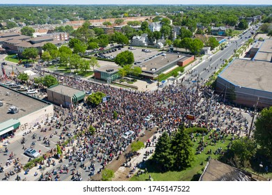 Minneapolis, MN / USA - May 30 2020: Aftermath of Riots Fueled by the Death of  George Floyd Under Police Custody. Thousands of Protestors Gather Outside of Minneapolis 5th Precinct Police Department.