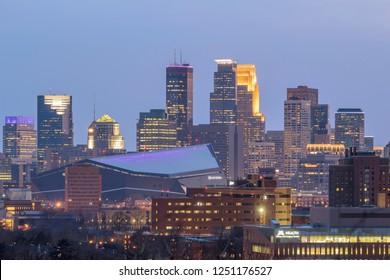 MINNEAPOLIS, MN - WINTER 2018 - A Telephoto Detail Shot on Downtown Minneapolis Skyline Illuminating During a Gloomy Twilight Hour