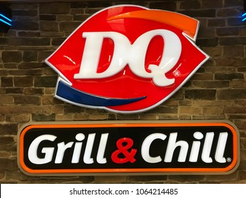 "Minneapolis, MN/USA April 3, 2018. Brick wall with a Dairy Queen sign including the slogan ""Grill & Chill."""
