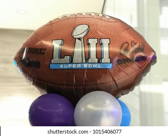 Minneapolis, MN/USA- February 1, 2018- Football shaped ballon against a light background which features the super bowl trophy and the Roman numerals LII celebrating  the Super Bowl.