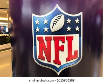 Minneapolis, MN/USA- February 2, 2018.  A purple pillar in the mall with the Shield of the NFL on display for the Super Bowl.