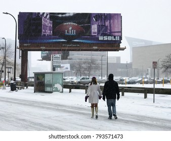Minneapolis, MN/USA - January 14, 2018 - Playoff Gameday in downton Minneapolis in the freezing cold. US Bank Stadium and a Super Bowl billboard are featured.