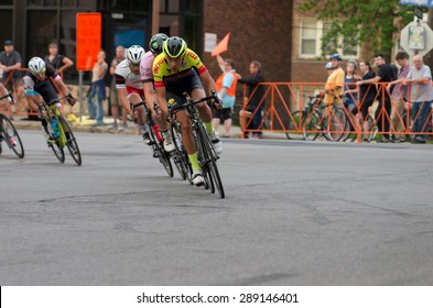 MINNEAPOLIS, MN/USA - JUNE 19, 2015: Pro cyclists lead pack at Uptown Criterium or stage four of prestigious 2015 North Star Grand Prix pro cycling event in Minneapolis.