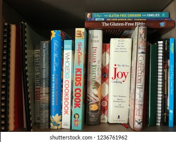 Minneapolis, MN/USA - June 25, 2018. Cookbooks on display in a kitchen in Minnesota. Some of the cookbooks included are gluten-free, Italian vegetarian and the Whole30 cookbook.