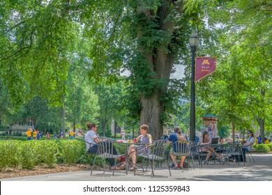 MINNEAPOLIS, MN/USA - JUNE 28, 2018: Unidentified individuals seated at the Northrop Mall on the east bank of the University of Minnesota.