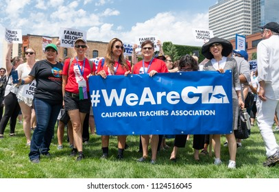 MINNEAPOLIS, MN/USA - JUNE 30, 2018: Unidentified individuals from the California Teachers Association at the Families Belong Together march.