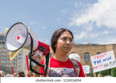 MINNEAPOLIS, MN/USA - JUNE 30, 2018: Unidentified individual holding a megaphone at  the Families Belong Together march in protest of U.S. Immigration policy separating migrant children from parents.
