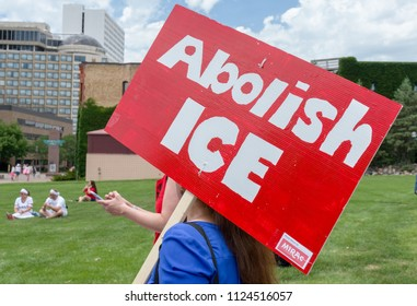 "MINNEAPOLIS, MN/USA - JUNE 30, 2018: Unidentified individual carrying a sign saying ""Abolish Ice"" at the Families Belong Together march."