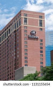 MINNEAPOLIS, MN/USA - JUNE 30, 2018: Hilton Hotel exterior and trademark logo. Hilton Hotels and Resorts is a global brand of full-service hotels.