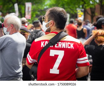 Minneapolis, MN/USA - June 4th 2020: A man wears a Colin Kaepernick jersey to George Floyd's memorial Service.