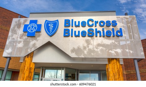 MINNEAPOLIS, MN/USA - MARCH 19, 2017: Blue Cross Blue Shield exterior and logo. Blue Cross Blue Shield Association (BCBSA) is a federation of health insurance organizations and companies.