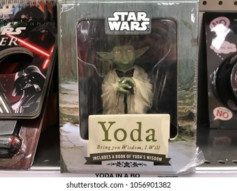 Minneapolis, MN/USA- March 28, 2018. Star Wars toys on display at a retail store in Minnesota featuring the Jedi Master Yoda.