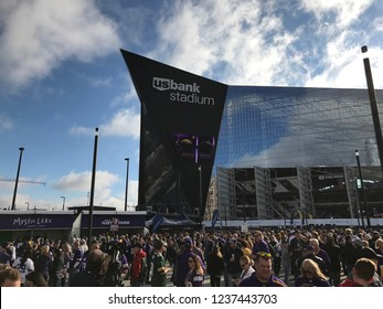 Minneapolis, MN/USA October 15, 2017. The scene outside of US Bank Stadium before the Packers faced the Vikings. Fans of both teams gather before this annual Border Battle between the two states.