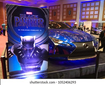 Minneapolis, MN/USA-March 14, 2018. A Black Panther display next to the Lexus LC 500 vehicle used in the film on display at an auto show in Minnesota.