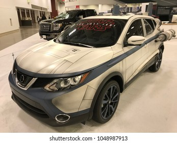 Minneapolis, MN/USA-March 14, 2018. Star Wars themed 2018 Nissan Rogue Sport vehicle that looks like an A-Wing at an auto show.