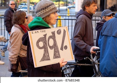 "MINNEAPOLIS - OCTOBER 29: An unidentified participant in a Occupy Minnesota protest holds up ""I'm am the 99%"" sign on October 29, 2011 in Minneapolis, MN.   Occupy protests are a worldwide movement against corporate greed."