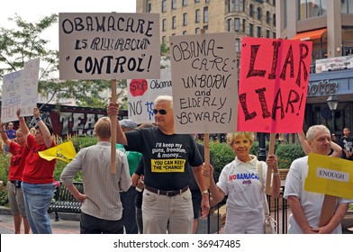 MINNEAPOLIS - SEPTEMBER 12: Health Care Reform protesters hold placards outside of Barack Obama's Health Care speech at the Target Center on September 12, 2009 in Minneapolis.