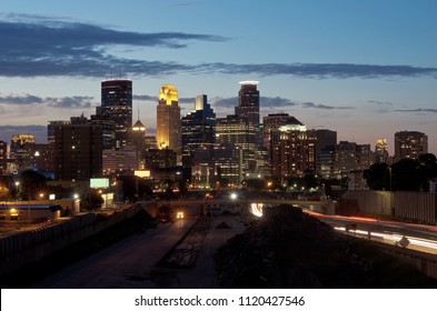 minneapolis skyline from 24th street pedestrian bridge overlooking 35w interstate and office towers of downtown in distance