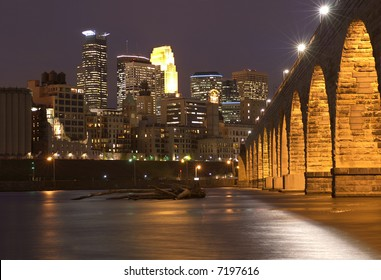 Minneapolis skyline at dusk with the Mississippi river and the Stone Arch Bridge