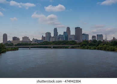 The Minneapolis Skyline as seen from the Northeast behind the Plymouth Avenue Bridge over the Mississippi. On the far left is the US bank (Vikings) Stadium. On the far right is Target Field (Twins).