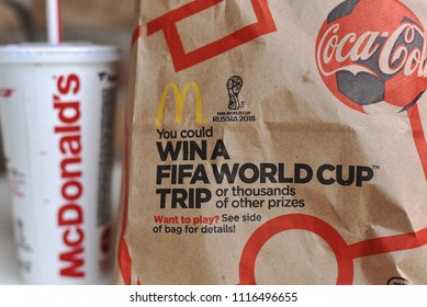 Minneapolis, United States - June 18, 2018: McDonald's paper bag with limited World Cup advertisement during a soccer filled summer.