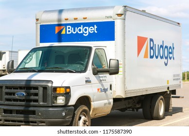 Minneapolis, United States - Sept 9th, 2018: Budget moving truck seen from front, isolated on industrial parking lot.