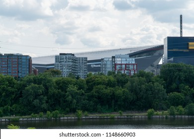 Minneapolis USA - Circa 2018: US Bank Stadium behind the Mississippi River waterfront skyline on a summer day. Home to Minnesota Vikings football team.