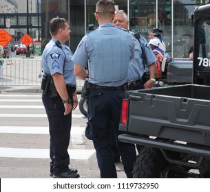 MINNEAPOLIS-JUNE 24,2018:  Minneapolis Police officers conferring in downtown Minneapolis, before the Twin Cities Pride Parade, on June 24, 2018.