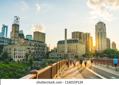 minneapolis,minesota,usa.  08-07-2017: mill ruins park,view on stone arch bridge at sunset.