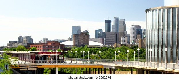 MINNEAPOLIS/USA - JULY 23: Downtown Minneapolis skyline from the campus of University of Minnesota on the campus of the University of Minnesota, the 6th largest university in the USA. July 23, 2012.