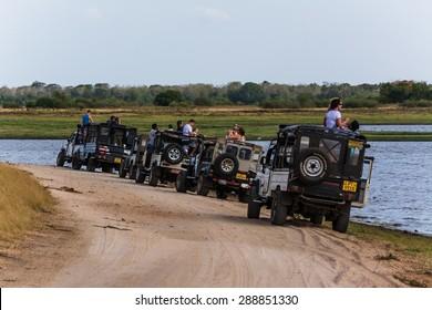 MINNERIYA NATIONAL PARK, SRI LANKA July 2, 2014: a couple of off-road jeeps on a safari in sri lanka