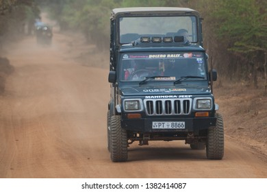 Minneriya, Sri Lanka. July 21, 2016: Minneriya National Park. A jeep carrying tourists visiting the famous national park of Sri Lanka. A car goes into the park in search of wild animals.