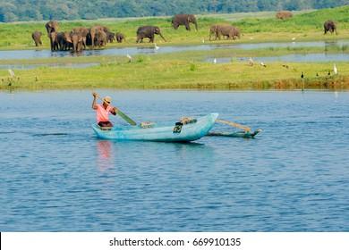 MINNERIYA, SRI LANKA – MARCH 19: Local tank fisherman fishing on reservoir in Minneriya National Park on March 19 2017 in Minneriya, Sri Lanka. The National Park famous for wild elephants