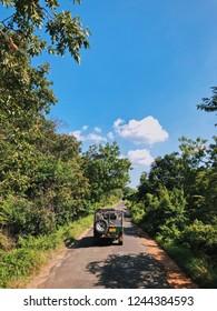 Minneriya, Sri Lanka- November, 15 2017: Tourist safari jeep in Minneriya National park near Kaudulla.