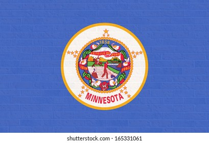 Minnesota state flag of America on brick wall, isolated on white background.