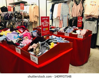 Minnetonka, Minnesota - May 27, 2019: Messy clearance bins of women's panties and undergarments in the lingerie department of a Macy's store