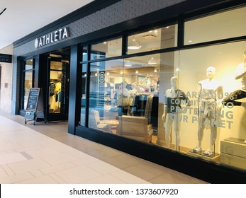 Minnetonka, MN - April 18, 2019: The exterior of an Athleta store at a the Ridgedale mall in Minnesota. This store sells athleisure and workout clothing for women